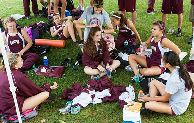 Kyle Grillot - kgrillot@shawmedia.com   The Marengo team relaxes under their tent  together after the McHenry County Cross Country meet at the McHenry Township Park Saturday, August 31, 2013.