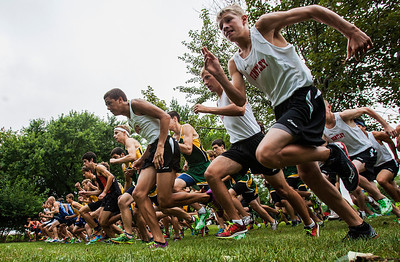 Kyle Grillot - kgrillot@shawmedia.com   The varsity boys take off at the start of the 3-mile race during the McHenry County Cross Country meet at the McHenry Township Park Saturday, August 31, 2013.