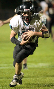 Kyle Grillot - kgrillot@shawmedia.com    Woodstock North junior senior Grant Wade (30) runs the ball in for a touchdown to tie up the game during the fourth quarter of the football game at McCracken field Friday, September 13, 2013. McHenry beat Woodstock North 35 - 28.