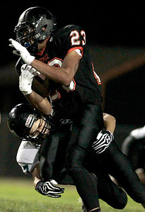 Kyle Grillot - kgrillot@shawmedia.com   McHenry senior Jordan Johnson (23) avoids the tackle attempt of Woodstock North junior Jacob Peschke (87) during the first quarter of the football game at McCracken field Friday, September 13, 2013. McHenry beat Woodstock North 35 - 28.