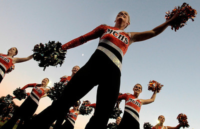 Kyle Grillot - kgrillot@shawmedia.com   McHenry dance team performs for the crowd before the start the football game between McHenry and Woodstock North at McCracken field Friday, September 13, 2013. McHenry beat Woodstock North 35 - 28.