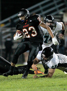 Kyle Grillot - kgrillot@shawmedia.com   McHenry senior Jordan Johnson (23) avoids being tackles by the Woodstock North defense during the third quarter of the football game at McCracken field Friday, September 13, 2013. McHenry beat Woodstock North 35 - 28.