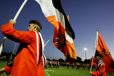 Kyle Grillot - kgrillot@shawmedia.com   McHenry junior Seth Beauban walks flags off the field with the pit crew before the start the football game between McHenry and Woodstock North at McCracken field Friday, September 13, 2013. McHenry beat Woodstock North 35 - 28.