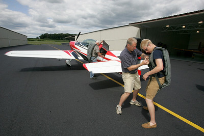 H. Rick Bamman -hbamman@shawmedia.com   Claude and Diane Sonday of Bull Valley bought Galt Airport in June at a foreclosure auction. Airport manager Justin Cleland (blu) Director of Aircraft maintanance Brian Spiro. Pilot Dave Monroe w/dog Brandon and dad Harvey Meek of Poplar Grove