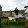 Edie Pomeroy, of Western Springs, sells a variety of antique items at the Antique Tool Show and Sale at Garfield Farm Museum in Campton Hills Sunday, Aug. 3.
