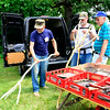 Dale Crosier, of Maroa, demonstrates how his 1800s inspired handmade rake is used at the Antique Tool Show and Sale at Garfield Farm Museum in Campton Hills Sunday, Aug. 3.