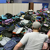 Jeff Krage – For Shaw Media<br /> Piles of backpacks sit on the floor of the Spartan Events Center at Elgin Community College waiting to be distributed to school children during Saturday's Project Backpack.<br /> Elgin 8/9/14