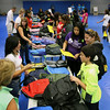 Jeff Krage – For Shaw Media<br /> Backpacks are distributed to families during Saturday's Project Backpack inside the Spartan Events Center at Elgin Community College.<br /> Elgin 8/9/14