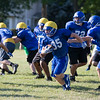 ACC running back  Jacob Bunce (35) carries the ball for a gain during practice at Aurora Central Catholic High School in Aurora, IL on Thursday, August 14, 2014 (Sean King for Shaw Media)