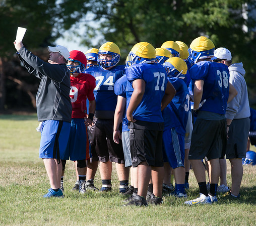ACC Head Coach calls a play during practice at Aurora Central Catholic High School in Aurora, IL on Thursday, August 14, 2014 (Sean King for Shaw Media)