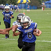 Jeff Krage – For Shaw Media<br /> Burlington 9U's Keith Ganziano carries the football Saturday during a Tri-City Chargers' Pigskin Classic game against the Leyden Bears at James O. Breen Park in St. Charles.<br /> St. Charles 8/16/14