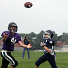 Jeff Krage – For Shaw Media<br /> Tri-City Chargers (Grades 7&8) wide receiver Daniel Majewski, left, looks for the football during a Tri-City Chargers' Pigskin Classic game against West Chicago at James O. Breen Park in St. Charles.<br /> St. Charles 8/16/14
