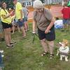Pam Feyereisen of North Aurora waits for the North Aurora Pet Parade to start Sunday with her pembroke corgi, Fiona.
