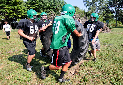 Michelle LaVigne - For Shaw Media Alden-Hebron High School's junior (back left,)Shane Bieze  junior (back right,) Taylor Glenn, sophomore (middle) Cameron Norton and sophomore Mason Mindham complete a drill during football practice in Hebron on August 14, 2015.
