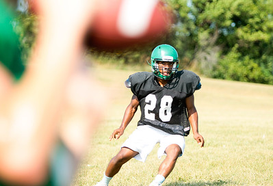 Michelle LaVigne - For Shaw Media Alden-Hebron High School senior Joshua Johnson keeps his eyes on the ball during  football practice in Hebron on August 14, 2015.