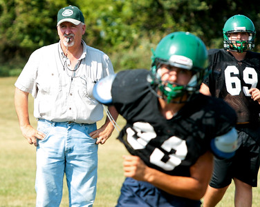 Michelle LaVigne - For Shaw Media Alden-Hebron High School head varsity coach John Lalor watches over practice in Hebron on August 14, 2015.