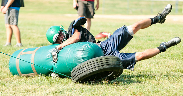 Michelle LaVigne - For Shaw Media Alden-Hebron High School senior Nate Peterson participates in a tackling drill during football practice in Hebron on August 14, 2015.