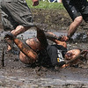 Team Muddogs Stephanie Santiago of St. Charles dives into the mud for a dig against the Tequila Mockingbirds during the 7th Annual Elburn Days Mud Volleyball Tournament at Lions Park, 500 S. Filmore St. in Elburn, IL on Sunday, August 23, 2015 (Sean King for Shaw Media)