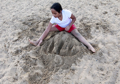 Candace H. Johnson Natalie Gonzalez, 9, of Round Lake makes a water maze in the sand during National Night Out at Lakefront Park in Round Lake Beach.