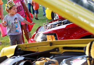 Candace H. Johnson Jordan Kemp, 5, of Round Lake Beach checks out the cars on display for the Car Show during National Night Out at Lakefront Park in Round Lake Beach.