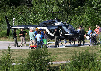 Candace H. Johnson People check out an Air-One Emergency Response Coalition helicopter during National Night Out at Lakefront Park in Round Lake Beach. Co-pilots Ed Sindles and Mark Smith talked with the crowd.