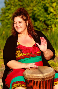 Candace H. Johnson Helen Bond with Medusa's Musical Mysteries, plays her drum in a drum circle during National Night Out at Lakefront Park in Round Lake Beach.