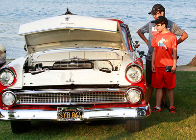 Candace H. Johnson Christopher Ayala, 16, of Round Lake and his brother, Gerardo, 13, check out a 1955 Ford Victoria in the Car Show during National Night Out at Lakefront Park in Round Lake Beach. The car was owned by Bill Beckett, of Round Lake Beach.