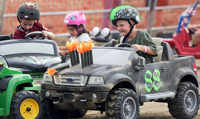 Logan Wischnia, 7 from Ingleside, mixes it up in the kids class of the Demolition Derby at the McHenry County Fair on Sunday, August 7, 2016 in Woodstock.  John Konstantaras photo for the Northwest Herald