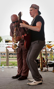 Jimmy Nick, right, from Crystal Lake, and saxophone player Rodney Brown, from Chicago, with the band Jimmy Nick & Don't Tell Moma play at the McHenry County Fair on Sunday, August 7, 2016 in Woodstock.  John Konstantaras photo for the Northwest Herald