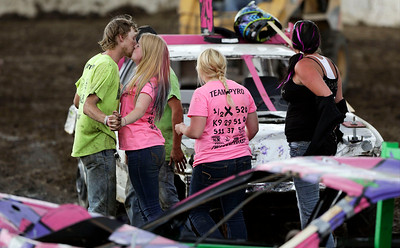Cliff Fandrich, from Ingleside, kisses his girlfriend Hannah Jackson, from Woodstock, after she won the Compact Class of the Demolition Derby at the McHenry County Fair on Sunday, August 7, 2016 in Woodstock.  John Konstantaras photo for the Northwest Herald