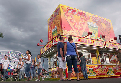 Storm clouds hover over the McHenry County Fair on the last day Sunday, August 7, 2016 in Woodstock.  John Konstantaras photo for the Northwest Herald