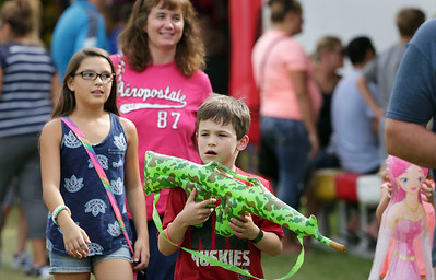 Matt Moritz, 7 from Crystal Lake, patrols the fairgrounds after winning a toy gun at the McHenry County Fair on Sunday, August 7, 2016 in Woodstock.  John Konstantaras photo for the Northwest Herald
