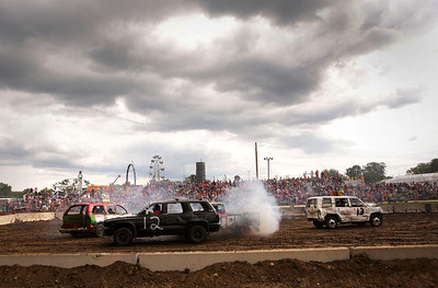 Victor Diaz, #12 from Woodstock, drives his Dodge Durango in the SUV class of the Demolition Derby at the McHenry County Fair on Sunday, August 7, 2016 in Woodstock.  John Konstantaras photo for the Northwest Herald