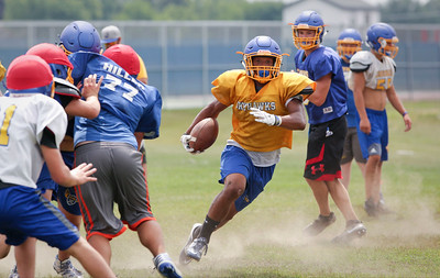 Alex Peete runs the ball during Johnsburg High School football practice on Wednesday August 10, 2016 in Johnsburg.  John Konstantaras photo for the Northwest Herald