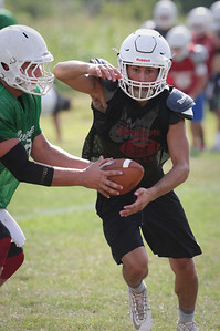 Elias Edmondson takes a hand off from Gavin Scott during Marian Central football practice on Wednesday August 10, 2016 in Woodstock.  John Konstantaras photo for the Northwest Herald