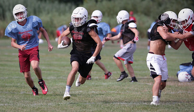 Elias Edmondson returns a punt during Marian Central football practice on Wednesday August 10, 2016 in Woodstock.  John Konstantaras photo for the Northwest Herald