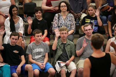 Jonny Krug, third from left, raises his hand during a session on student activities as he attends freshman orientation at McHenry West High School on Thursday August 10, 2016.  John Konstantaras photo for the Northwest Herald