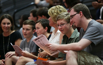 "Jonny Krug, second from right, looks over papers with his senior brother Robby as they wait for a session on ""Growth Mindset"" to begin during freshman orientation at McHenry West High School on Thursday August 10, 2016.  John Konstantaras photo for the Northwest Herald"