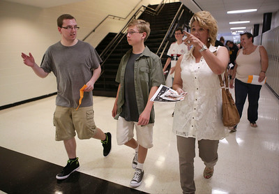 Jonny Krug walks through the halls with his senior brother Robby and his mother Christmas during freshman orientation at McHenry West High School on Thursday August 10, 2016.  John Konstantaras photo for the Northwest Herald