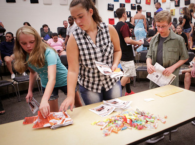 Jonny Krug right pick up materials during a session on student activities during freshman orientation at McHenry West High School on Thursday August 10, 2016.  John Konstantaras photo for the Northwest Herald