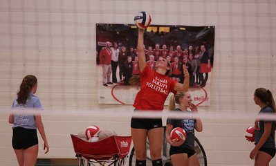 McKayla Wuensch serves during Marian Central's first volleyball practice of the season on Wednesday, August 10, 2016 in Woodstock.  John Konstantaras photo for the Northwest Herald