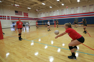 Lauren Hanlon returns a ball during Marian Central's first volleyball practice of the season on Wednesday, August 10, 2016 in Woodstock.  John Konstantaras photo for the Northwest Herald
