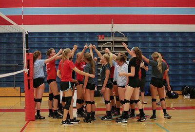 Players gather at practice during Marian Central's first volleyball practice of the season on Wednesday, August 10, 2016 in Woodstock.  John Konstantaras photo for the Northwest Herald