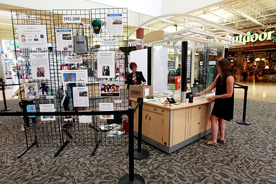 Candace H. Johnson Bonni Pear and Erin McGraw, publicists, put together the time capsule display at Entry E outside of Bass Pro Shops Outdoor World with the items found after the public unearthing of a 1991 time capsule to commemorate the 25th Anniversary of Gurnee Mills in Gurnee.