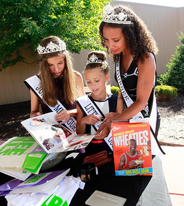 Candace H. Johnson Gurnee 2016 Queens: Jr. Miss: Emily Hetman, 12, Little Miss: Morgan Ghys, 9, and Miss: Leah Davis, 17, look through the items discovered after the public unearthing of the 1991 time capsule to commemorate the 25th Anniversary of Gurnee Mills in Gurnee.