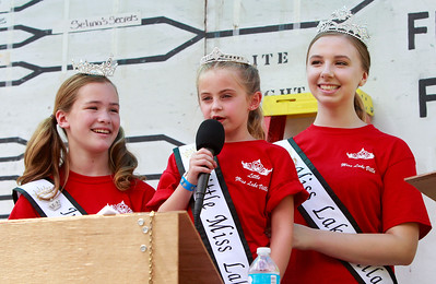 Candace H. Johnson Lake Villa 2016 Queens: Jr. Miss: Brighton Callaway, 11, and Miss: Brittany Gallarneau, 17, support Little Miss: Mia Green (center) as she talks to the crowd during the water fights for Lake Villa Days at Lehmann Park in Lake Villa.
