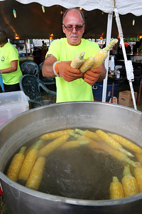 Candace H. Johnson Richard O'Brien, of Lake Villa, a retired Lake Villa firefighter, boils corn in a big pot near the food tent during Lake Villa Days at Lehmann Park in Lake Villa. O'Brien worked for the Lake Villa Fire Dept. for thirty-five years.