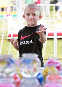 Candace H. Johnson Jax Prorok, 7, of Lindenhurst plays the goldfish game during Lake Villa Days at Lehmann Park in Lake Villa.