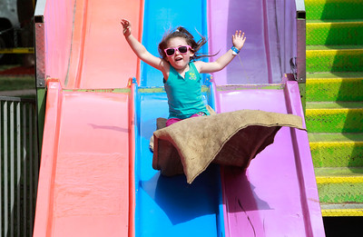 Candace H. Johnson Vayda Vaughn, 4, of Antioch rides down the Superslide during Lake Villa Days at Lehmann Park in Lake Villa.