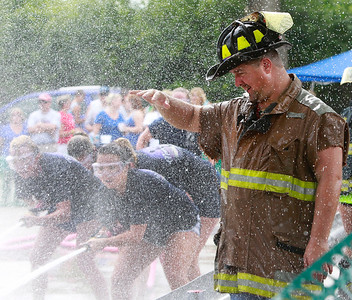 Candace H. Johnson Rich Hoehne, chief fire engineer with the Fox Lake Fire Dept., gets really wet supervising the water fights during Lake Villa Days at Lehmann Park in Lake Villa.